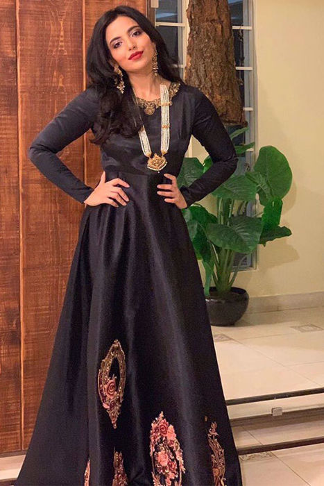 Picture of The ever gorgeous Fatima Zara Mallick @fatimazaramallick_ @fzm_boutique_fitness makes a dazzling impression in our black silk gown with Victorian floral framed motifs