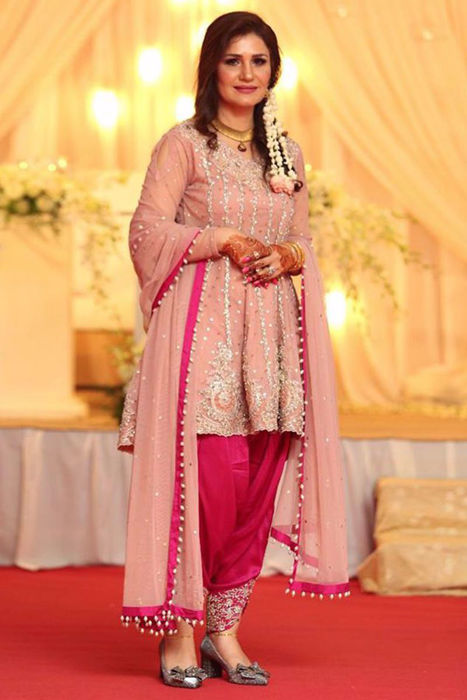 Picture of Our lovely client wears one of the designs from ZC Luxury formals collection