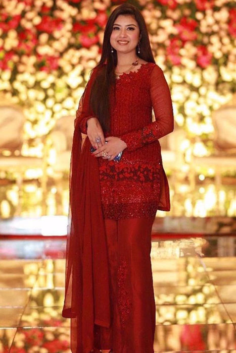 Picture of Glowing in Red! Our client Maryam Khan seen here in Flamenco Red from ZC formals